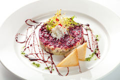 Traditional russian salad. With salted herring and beet root isolated on white background Stock Photography