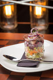 Traditional russian salad with salted herring and beet root Stock Photos