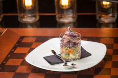 Traditional russian salad with salted herring and beet root Stock Images