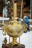 Traditional Russian Samovar, a metal container used to heat and boil water for tea ceremony. Outdoor. Gold edition stock photo