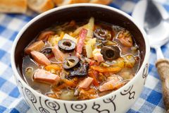 Traditional russian Soljanka soup. Traditional tasty russian Soljanka soup in a bowl Stock Images