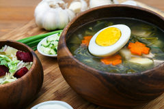 Traditional Russian sorrel soup. With egg in wooden bowl royalty free stock photos