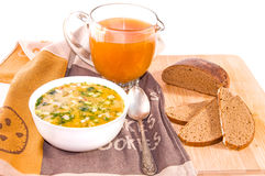Traditional russian soup okroshka, jug of kvass and bread. Traditional russian summer cold kvass soup okroshka with chopped potatoes, eggs, fresh cucumber Stock Photos