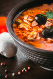 Traditional Russian soup solyanka. Closeup in a bowl on the table Royalty Free Stock Photo