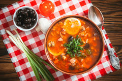 Traditional Russian soup solyanka. Closeup in a bowl on the table Royalty Free Stock Images