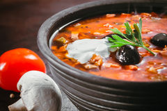 Traditional Russian soup solyanka. Closeup in a bowl on the table Royalty Free Stock Image