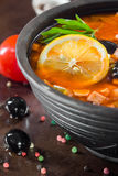 Traditional Russian soup solyanka. Closeup in a bowl on the table Royalty Free Stock Photography