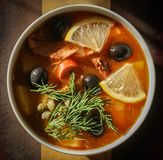 Traditional Russian soup solyanka closeup in a bowl on the table. Horizontal top view Stock Photography