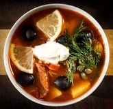 Traditional Russian soup solyanka closeup in a bowl on the table. Horizontal top view Royalty Free Stock Image
