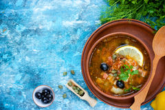 Traditional Russian soup solyanka - soup with lemon meat olive c Royalty Free Stock Image