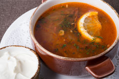 Traditional russian soup. Solyanka with sour cream Royalty Free Stock Photography