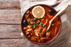 Traditional Russian soup solyanka on the table. Horizontal top v Royalty Free Stock Photos