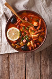 Traditional Russian soup solyanka on the table. Vertical top vie. Traditional Russian soup solyanka closeup in a bowl on the table. Vertical top view Stock Photography