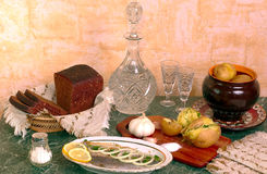 Traditional russian talbe. Russian table appointment - boiled potatos, bread, herring and vodka Royalty Free Stock Photo