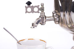 Traditional russian tea kettle faucet and teacup Stock Image