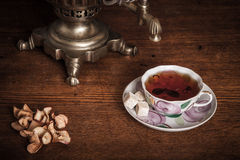 Traditional Russian tea. Samovar, bagels and dried apples Royalty Free Stock Images