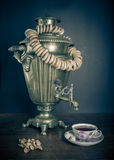 Traditional Russian tea. Samovar, bagels and dried apples Royalty Free Stock Photography