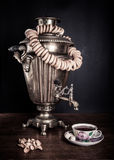 Traditional Russian tea. Samovar, bagels and dried apples Stock Images
