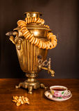 Traditional Russian tea. Samovar, bagels and dried apples Royalty Free Stock Photo