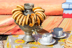 Traditional Russian tea from Samovar with bagels Stock Photos