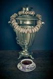 Traditional Russian tea. Samovar and dangling it on ligament bag Stock Images