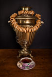 Traditional Russian tea. Samovar and dangling it on ligament bag Royalty Free Stock Images