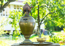 Traditional russian tea with samovar in the garden. Summer day stock photos