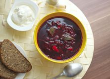 Red borscht or beetroot soup with sour cream. Royalty Free Stock Photography