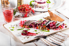 Traditional Russian and Ukrainian vegetable salad Vinaigrette on a served table.  Stock Photos