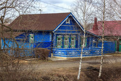 Traditional russian village house in Yuryev-Polsky. Classic Russian village house with three windows of sky blue color Royalty Free Stock Photo