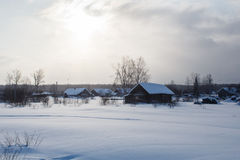 Traditional russian village in wintertime during sunset Royalty Free Stock Photography