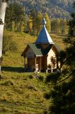 The traditional russian wooden church. At Teletskoye Lake Stock Photo