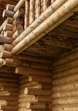 Traditional Russian wooden construction, the corner of the house with logs, round bars on the wall of the house, the ends of fell Royalty Free Stock Photos