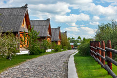 Traditional russian wooden houses in spring. Royalty Free Stock Photography