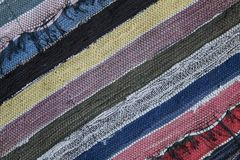 Traditional rustic carpet with a striped pattern. stock images