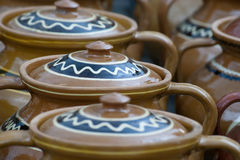 Traditional rustic pottery from Romania. Traditional earthenware rustic pottery from Romania Stock Photos