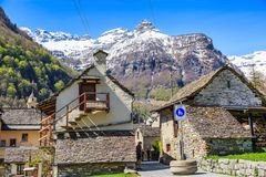 Traditional rustic stone houses in Sonogno. SONOGNO, SWITZERLAND - 21 APRIL 2018 - Traditional rustic stone houses in Sonogno village in Locarno district Royalty Free Stock Photography