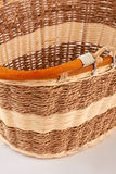 Traditional rustic wicker basket isolated. Wooden container on white background stock photo