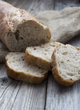 Traditional rye bread slices. On wood background Royalty Free Stock Photography