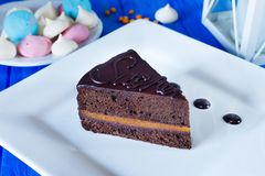 Traditional sacher cake sliced on white squared plate stock photo