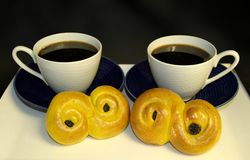Traditional saffron buns with coffee cups, tradition in Sweden at Lucia and Christmas, in Swedish languag called stock photo