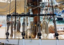 Traditional sailboat rigging. Various nautical knots. Yacht standing in port of Barcelona, Spain. Various nautical knots. Traditional sailboat rigging Royalty Free Stock Images
