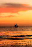 Traditional sailing boat in silhouette with a tropical sunset Royalty Free Stock Photography