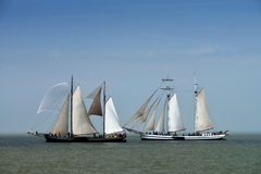 Traditional sailing ships on the IJsselmeer, the Netherlands. Volendam is a port with about 22,000 residents. Tourists visit the village in search of historical Royalty Free Stock Photography