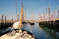 Traditional sailing yacht runs tidal harbor Royalty Free Stock Photos