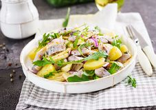 Traditional salad of salted herring fillet, fresh apples, red onion and potatoes. Kosher food. Scandinavian cuisine royalty free stock photo
