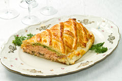 Traditional salmon in puff pastry Stock Photos