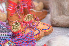 Traditional sami handmade leather footwear made from reindeer hide. Traditional sami handmade leather footwear for children made from reindeer hide with Stock Images