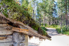 Traditional Sami loghouse with green roof in Lapland Scandinavia stock photography