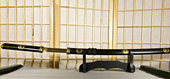 Traditional Samurai sword. Traditional Japanese samurai sword mounted on special black wooden stand Stock Photo